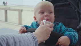 A child drinks from a straw juice closeup stock footage