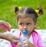 Child drinks water Stock Photography