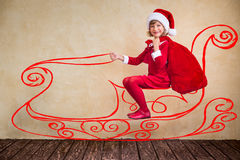 Child drive in imaginary Santa sleigh Stock Image