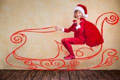 Child drive in imaginary Santa sleigh Stock Image
