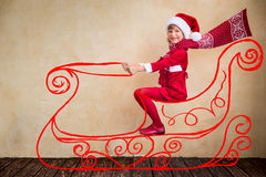 Child drive in imaginary Santa sleigh Royalty Free Stock Photography