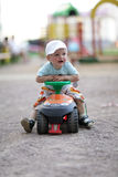 Child drives toy Quad Bike Royalty Free Stock Image