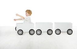 Child driving box car and empty wagons Royalty Free Stock Photo