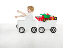 Child driving box car and wagon with toys. Delivery and shipping concept Stock Photo
