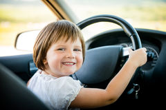Child driving car Stock Photos