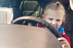 Child driving a car Stock Images