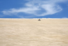 A child driving desert scooter in desert, bahrain Royalty Free Stock Photo