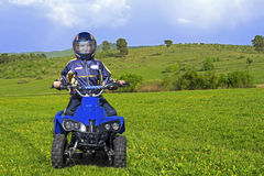 Child driving a mini ATV Stock Photo