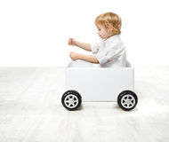 Child driving toy box car. royalty free stock photo