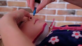 The child is dropped into the nose drops from the common cold. Close-up slow motion video stock video