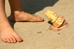 Child Drops Ice Cream Cone by Feet Stock Images