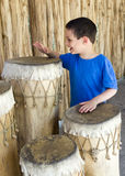 Child drumming Royalty Free Stock Photo