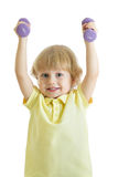 Child with dumbbells. Portrait of sporty kid boy in yellow t-shirt on white background. Stock Photos