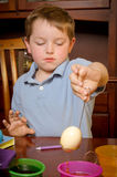 Child dying eggs Stock Images