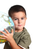 Child with earth globe Stock Images
