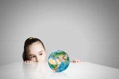 Child and Earth planet Royalty Free Stock Photography