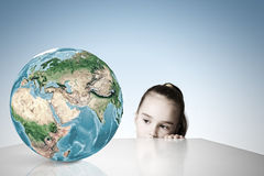Child and Earth planet Stock Images