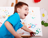 Child with easel draw hands. Preschool stock photography