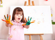 Child with easel in  preschool. Royalty Free Stock Photography