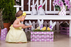 Child with Easter bunny and chicks Royalty Free Stock Photo