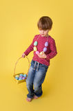 Child with Easter Egg Basket, Egg Hunt Royalty Free Stock Photos