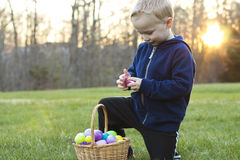 Child at an Easter Egg Hunt. Child searching for eggs at an Easter Egg Hunt on a Sunny day Stock Image