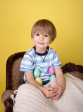 Child with Easter Eggs at  Home Royalty Free Stock Photography