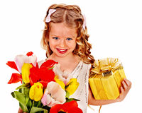Child with easter flower and gift box. Royalty Free Stock Images