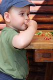 Child eat berry Royalty Free Stock Photos