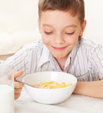 Child eat breakfast at home Stock Photos