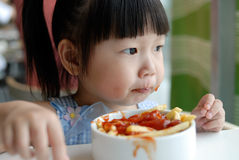 The child eat fries. Concentrate on the child to eat Fries Stock Photos