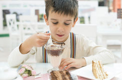Child eat milk choco shake. On a table Stock Photography