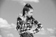 Child eat ripe apple fall harvest. Fruit vitamin nutrition for kids. Apple fruit diet. Kid hold ripe apple sunny day. Kid girl with long hair eat apple blue royalty free stock photo