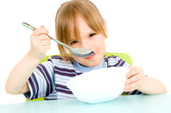 Child eat soup Royalty Free Stock Images