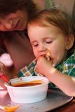 Child eating Stock Images