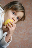 Child eating an apple stock photography