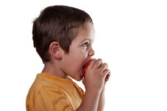 Child eating an apple Stock Photo