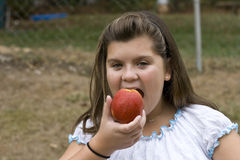 Child eating Apple Royalty Free Stock Photos