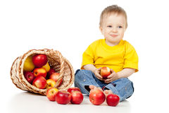 Child eating apple from basket. Child eating apple and basket Royalty Free Stock Photos