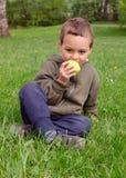 Child eating apple Stock Photos