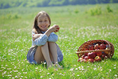 Child eating apple in a field Royalty Free Stock Images
