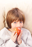 child eating apple Stock Photo