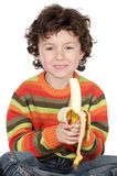 Child eating a banana Stock Photos