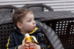 Child eating banana Stock Photography