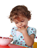 Child eating berry Stock Photos