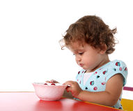 Child eating berry Stock Photo