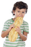 Child eating bread Stock Image