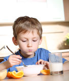 Child eating breakfast Stock Image