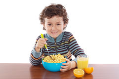 Child eating breakfast Royalty Free Stock Images