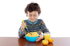 Child eating breakfast Royalty Free Stock Photos